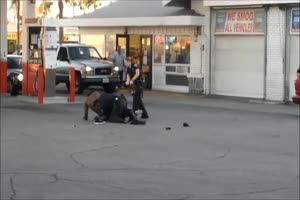 Female Cop Tirelessly Beats Man with her Baton